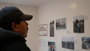 A man looks at a photo exhibit