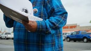 A man holds information about the community organization.