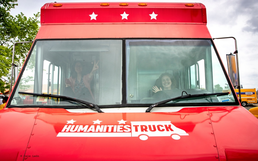 Two women sit in the front of the Humanities Truck