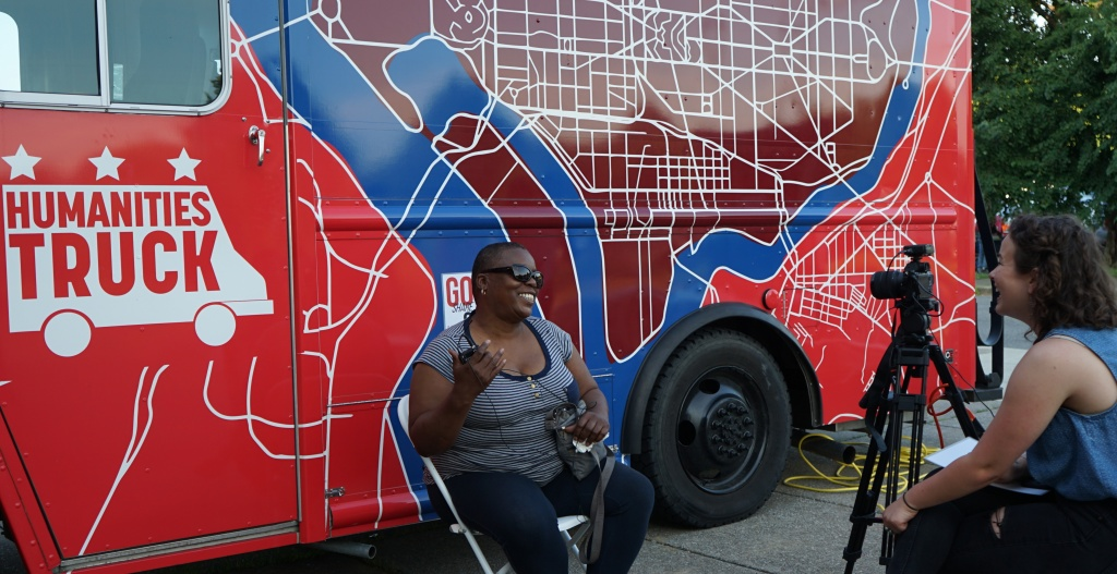 Maren Orchard interviews a woman outside the Humanities Truck.