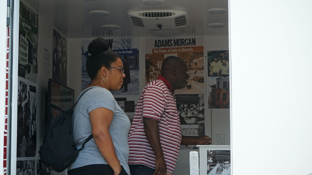 Two visitors look inside the Humanities Truck.
