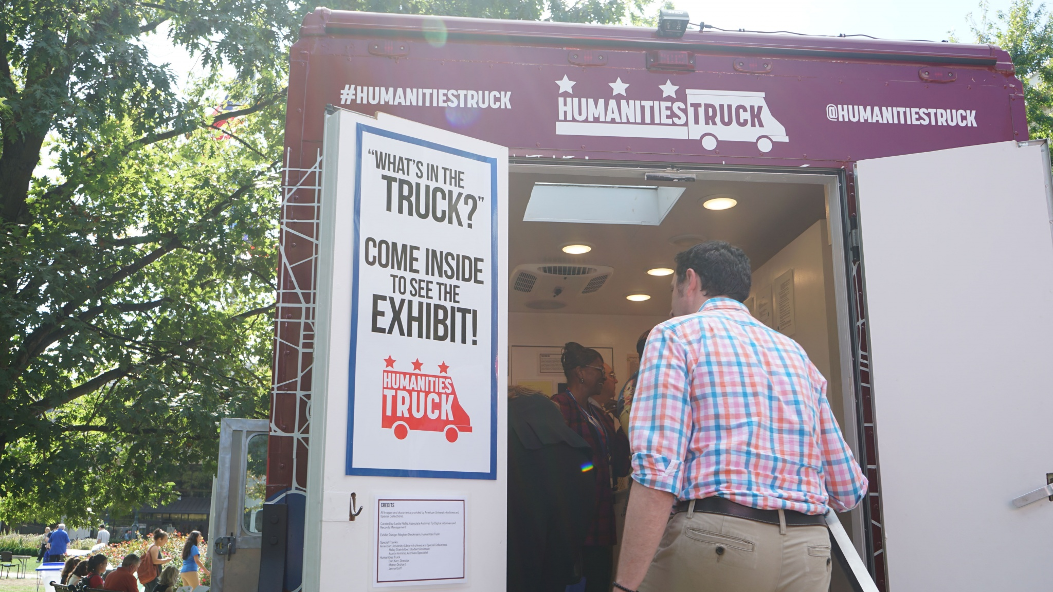 A man enters the packed Humanities Truck exhibit.